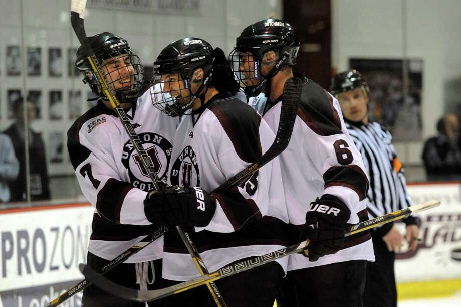 Union's Matt Hatch (15), center, celebrates his second period goal with teammates Josh Jooris (7), left, and Charlie Vasaturo (6) to make their hockey game 2-1 against Yale on Friday, Feb. 15, 2013, at Union College in Schenectady, N.Y.  (Cindy Schultz / Times Union) Photo: Cindy Schultz / 00021139A