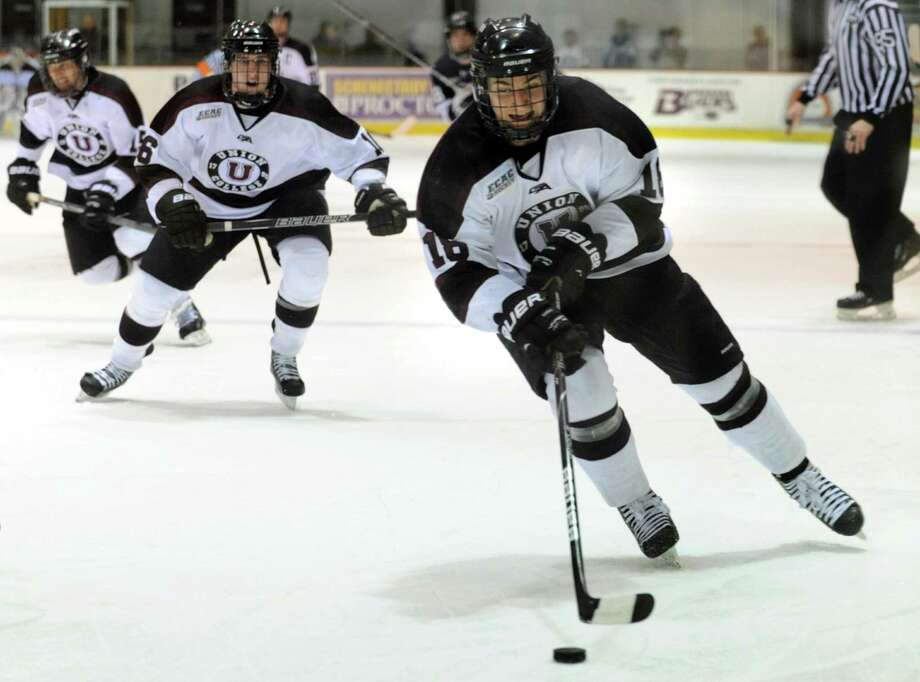 Union's Max Novak (18), right, skates for the opponent's net during their hockey game against Yale on Friday, Feb. 15, 2013, at Union College in Schenectady, N.Y.  (Cindy Schultz / Times Union) Photo: Cindy Schultz / 00021139A