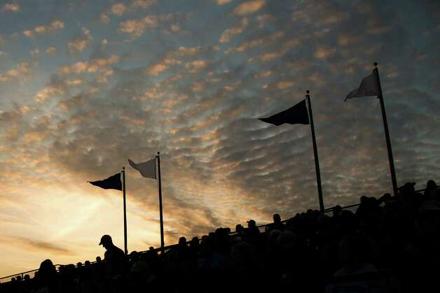 The sun sets over fans watching the Rice Owls victory over Stanford in their season opener at Reckling Park, Friday, Feb. 15, 2013, in Houston. Photo: Smiley N. Pool, Houston Chronicle / © 2013  Houston Chronicle