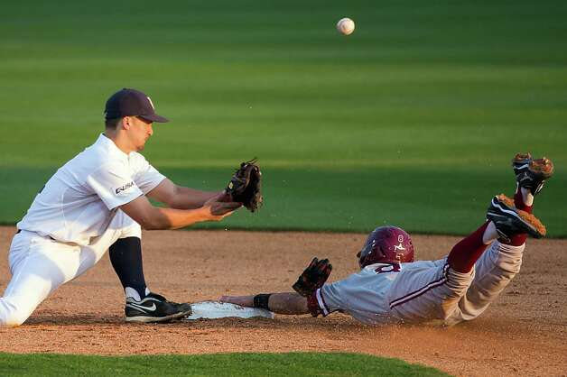 Stanford infielder Lonnie Kauppila (8) steals second base as the throw gets away from Rice shortstop Ford Stainback (11). Photo: Smiley N. Pool, Houston Chronicle / © 2013  Houston Chronicle