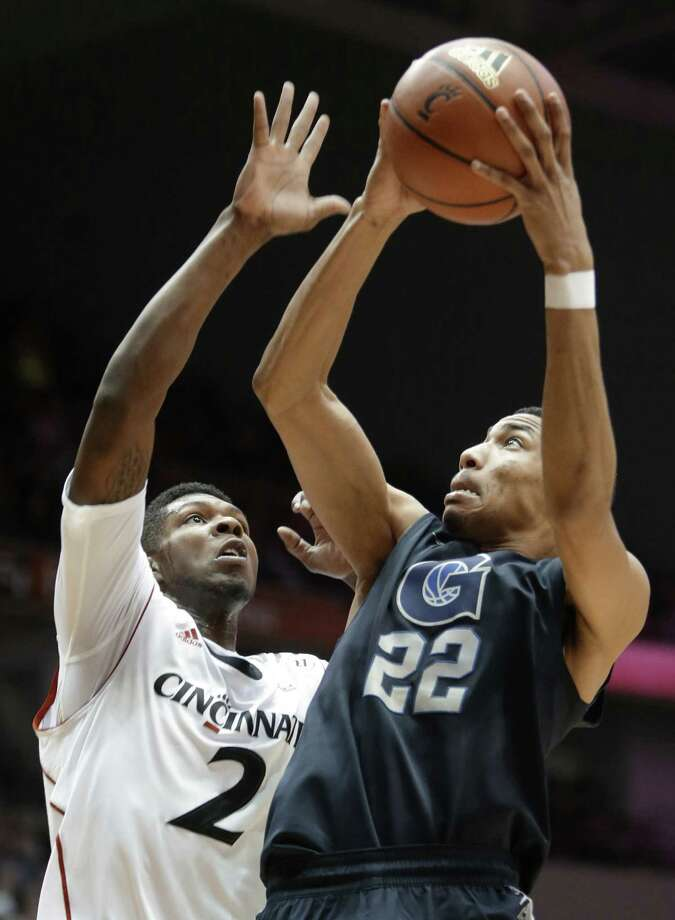 Georgetown's Otto Porter Jr. (right) shoots against Cincinnati's Titus Rubles in the Hoyas' win Friday. Porter scored 16 points. Photo: Al Behrman / Associated Press