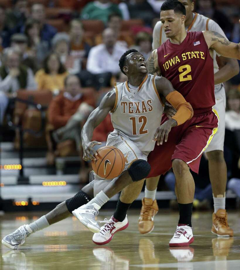 Texas' Myck Kabongo scored 13 points and dished out seven assists in a double-overtime victory over Iowa State on Wednesday. He and the Longhorns visit the Kansas Jayhawks tonight. Photo: Eric Gay / Associated Press