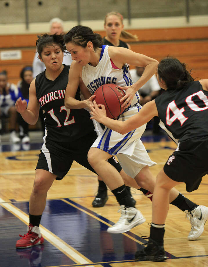 Mikki Flores helped seal Churchill's win with four free throws.