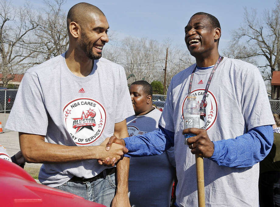 Spurs forward Tim Duncan and former Houston Rockets center Dikembe Mutombo share a laugh while helping volunteers construct the 5th Ward Legends Playspace on Friday in Houston as part of All-Star weekend. Photo: Edward A. Ornelas / San Antonio Express-News