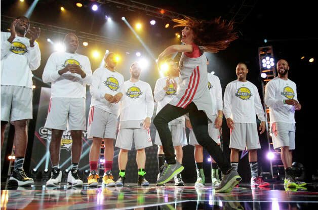 Television personality Samantha Harris twirls in front of her teammates during the 2013 Sprint All-Star Celebrity game. Photo: Billy Smith II, Houston Chronicle / © 2013 Houston Chronicle