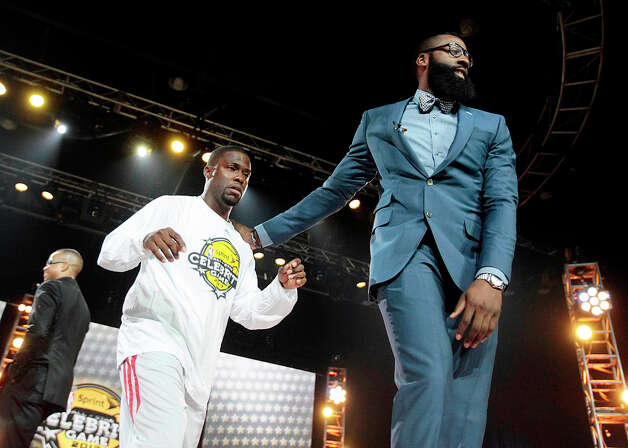 (l-r) Comedian Kevin Hart is led by his coach Houston Rockets guard James Harden during the 2013 Sprint All-Star Celebrity game. Photo: Billy Smith II, Houston Chronicle / © 2013 Houston Chronicle
