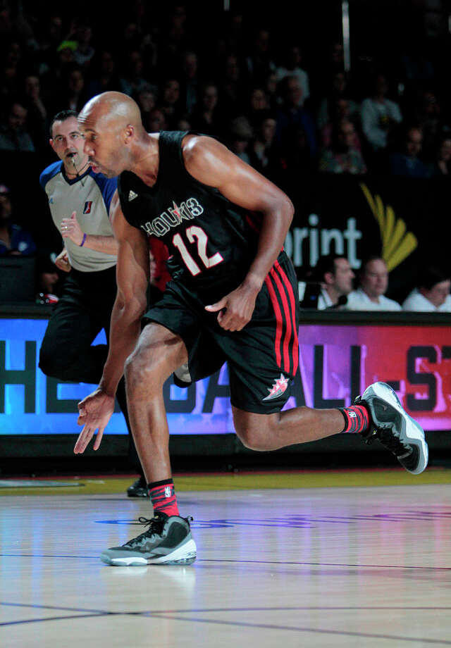 Former NBA great Bruce Bowen celebrates a made three pointer during the 2013 Sprint All-Star Celebrity game. Photo: Billy Smith II, Houston Chronicle / © 2013 Houston Chronicle