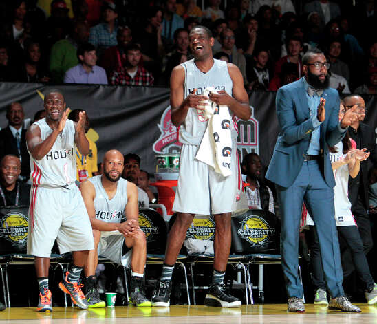 Comedian Kevin Hart cheers along with former Houston Rockets center Dikembe Mutombo and current Rockets all-star James Harden during the 2013 Sprint All-Star Celebrity game. Photo: Billy Smith II, Houston Chronicle / © 2013 Houston Chronicle