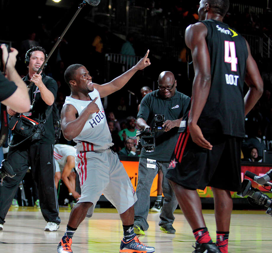 Comedian Kevin Hart celebrates after beating gold medal Olympic sprinter Usain Bolt in a foot race during the 2013 Sprint All-Star Celebrity game. Photo: Billy Smith II, Houston Chronicle / © 2013 Houston Chronicle