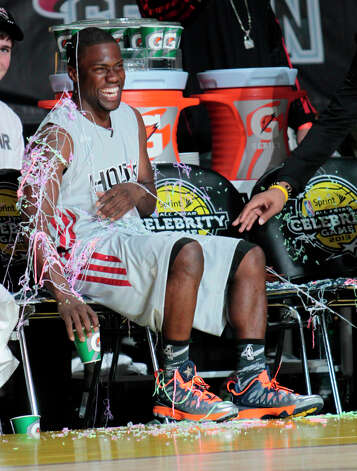 Comedian Kevin Hart laughs after getting hit with silly string during the 2013 Sprint All-Star Celebrity game. Photo: Billy Smith II, Houston Chronicle / © 2013 Houston Chronicle