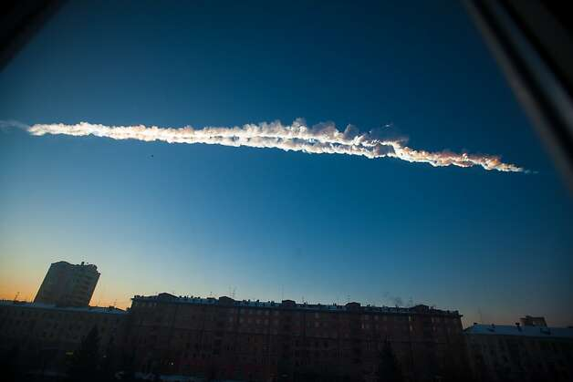 In this photo provided by Chelyabinsk.ru a meteorite contrail is seen over Chelyabinsk on Friday, Feb. 15, 2013. A meteor streaked across the sky of Russia's Ural Mountains on Friday morning, causing sharp explosions and reportedly injuring around 100 people, including many hurt by broken glass.  Photo: Yekaterina Pustynnikova, Associated Press