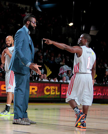 Houston Rockets guard James Harden has a talk with comedian Kevin  Hart during the 2013 Sprint All-Star Celebrity game. Photo: Billy Smith II, Houston Chronicle / © 2013 Houston Chronicle