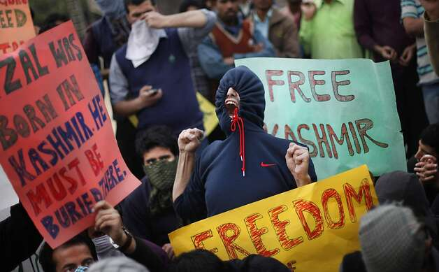 Kashmiri students shout freedom slogans during a protest against the execution of a Kashmiri Mohammed Afzal Guru and continuous curfew in the Kashmir valley, in New Delhi, India, Friday, Feb. 15, 2013. Authorities re-introduced a strict curfew across most of Indian-controlled Kashmir ahead of Friday prayers, as residents simmered with anger over the secret execution of Guru in the Indian capital. Guru had been convicted of involvement in a 2001 attack on India's Parliament that killed 14 including five gunmen.  Photo: Altaf Qadri, Associated Press