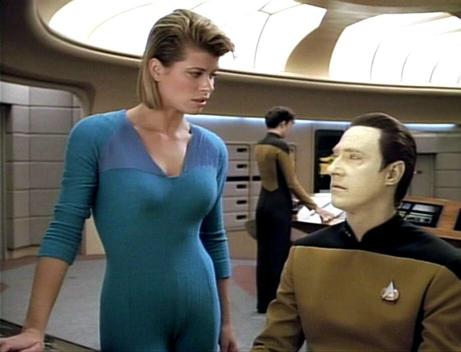 Beth Toussaint was an '80s-era hottie who played Ishara Yar. She's pictured with Brent Spiner as Data and a hideous bodysuit.