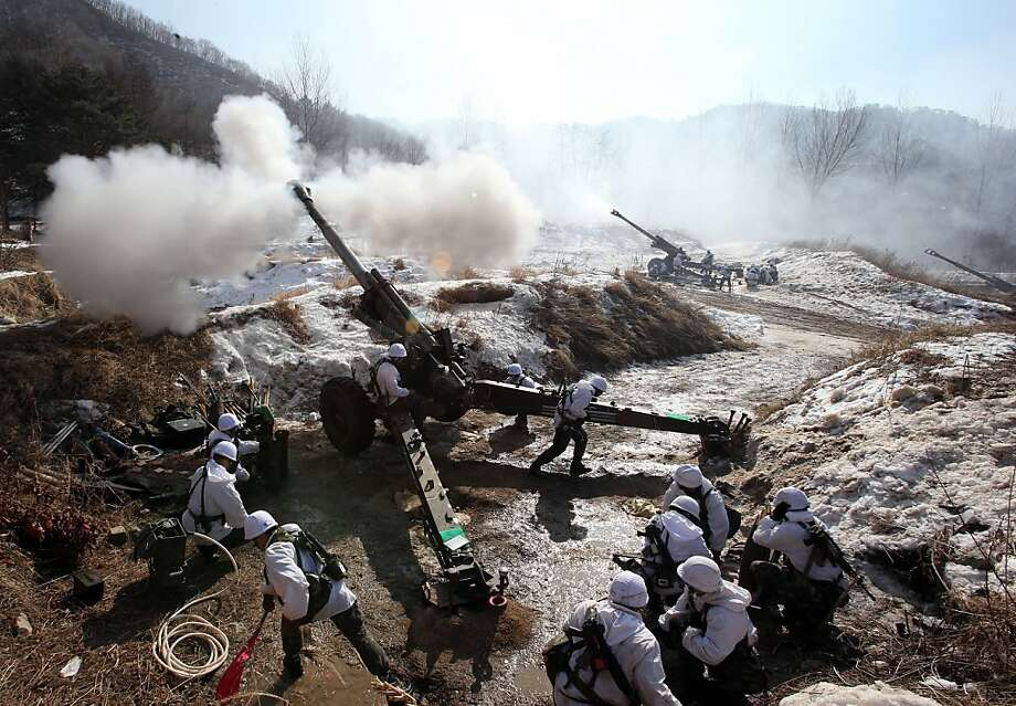 South Korean Army 155mm Howitzers fire live rounds during a live fire drill in Cheorwon, 70 km northeast of Seoul on February 15, 2013.  North Korea can never be made to abandon its nuclear weapons programme, South Korean President Lee Myung-Bak said on February 15, arguing that only regime collapse could remove the threat from Pyongyang. Photo: Yonhap, AFP/Getty Images