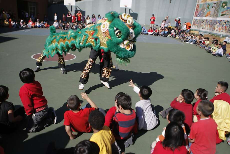 Jing Mo Athletic Association performs a lion dance for the students at Garfield Elementary in San Francisco, Calif. on February 15th, 2013. To usher in the Year of the Snake, a local group Jing Mo performed a lion dance at Garfield Elementary. Garfield is a school of about 250 students nestled in the hills of North Beach/Chinatown. Photo: Jessica Olthof, The Chronicle