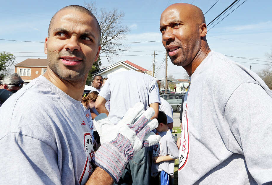 San Antonio Spurs' Tony Parker (left) and former San Antonio Spurs' Bruce Bowen talk while helping volunteers construct the 5th Ward Legends Playspace Friday Feb. 15, 2013 in Houston, Tx. The event is part of the NBA All-Star weekend. Photo: Edward A. Ornelas, San Antonio Express-News / © 2013 San Antonio Express-News