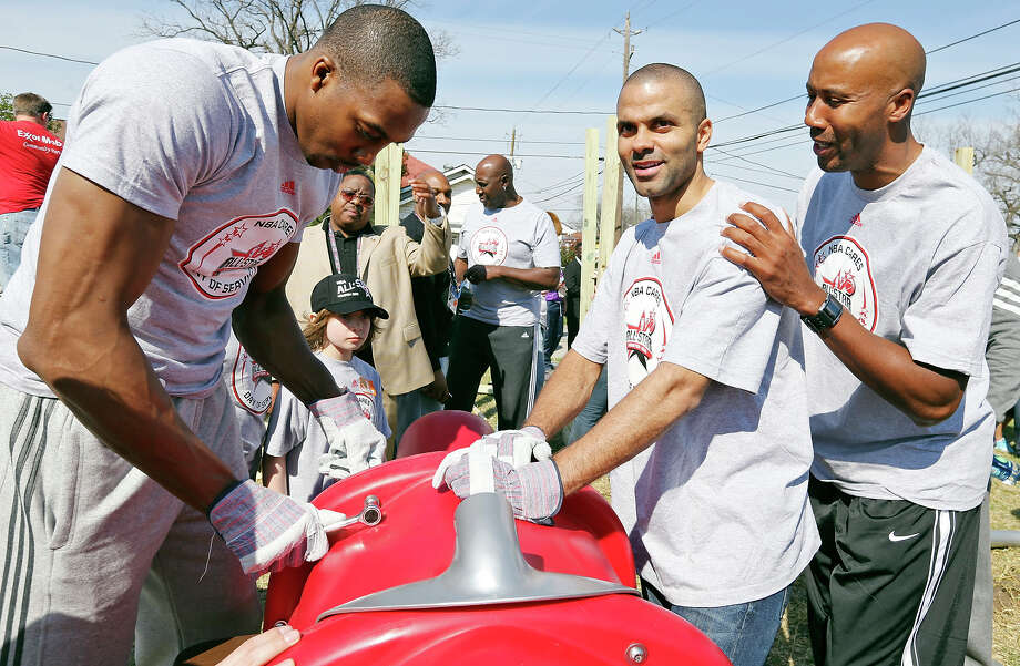 Los Angeles Lakers' Dwight Howard (from left), San Antonio Spurs' Tony Parker and former San Antonio Spurs' Bruce Bowen help volunteers construct the 5th Ward Legends Playspace Friday Feb. 15, 2013 in Houston, Tx. The event is part of the NBA All-Star weekend. Photo: Edward A. Ornelas, San Antonio Express-News / © 2013 San Antonio Express-News