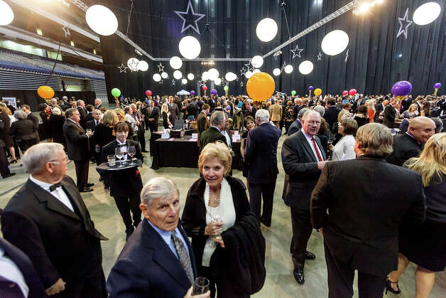 The crowd mingles in the silent auction area of the San Antonio Sports Hall of Fame Class of 2013 induction ceremony at the Alamodome on Friday, Feb. 15, 2013.  MARVIN PFEIFFER/ mpfeiffer@express-news.net Photo: MARVIN PFEIFFER, Marvin Pfeiffer/ Express-News / Express-News 2013