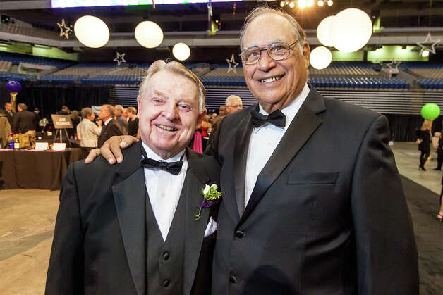Joe Conrad (left) poses for a photo with 2011 inductee Joe Cortez during the San Antonio Sports Hall of Fame Class of 2013 induction at its annual black-tie ceremony at the Alamodome on Friday, Feb. 15, 2013.  MARVIN PFEIFFER/ mpfeiffer@express-news.net Photo: MARVIN PFEIFFER, Marvin Pfeiffer/ Express-News / Express-News 2013