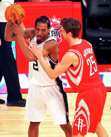 Team Chuck's Kawhi Leonard looks for room around Team Shaq's Chandler Parsons during first half action of the BBVA Rising Stars Challenge at the Toyota Center Friday Feb. 15, 2013 in Houston, Texas. Photo: Edward A. Ornelas, San Antonio Express-News / © 2013 San Antonio Express-News