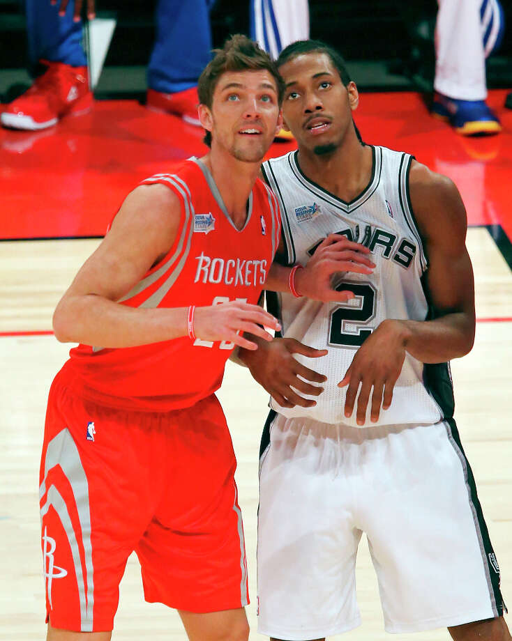 Team Shaq's Chandler Parsons (left) and Team Chuck's Kawhi Leonard watch a shot during first half action of the BBVA Rising Stars Challenge at the Toyota Center Friday Feb. 15, 2013 in Houston, Texas. Photo: Edward A. Ornelas, San Antonio Express-News / © 2013 San Antonio Express-News