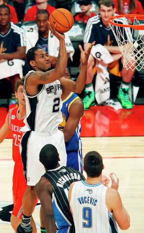 Team Chuck's Kawhi Leonard shoots against Team Shaq defenders during first half action of the BBVA Rising Stars Challenge at the Toyota Center Friday Feb. 15, 2013 in Houston, Texas. Photo: Edward A. Ornelas, San Antonio Express-News / © 2013 San Antonio Express-News