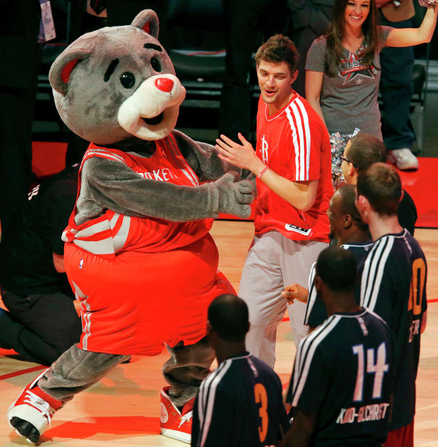 Houston Rockets mascot Clutch greets Team Shaq's Chandler Parsons before the BBVA Rising Stars Challenge at the Toyota Center Friday Feb. 15, 2013 in Houston, Texas. Photo: Edward A. Ornelas, San Antonio Express-News / © 2013 San Antonio Express-News
