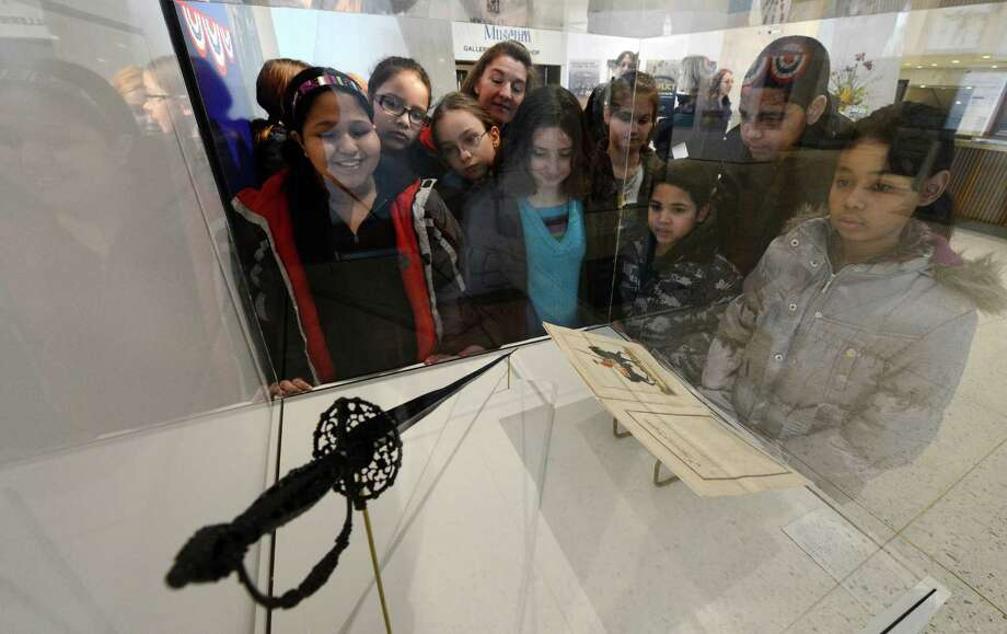 Students from Mindy Whisenhunt's dual language class from the Delaware Community Public School look at George Washington's sword Friday morning,  Feb. 15, 2013, at the New York State Museum in Albany, N.Y. (Skip Dickstein/Times Union) Photo: SKIP DICKSTEIN