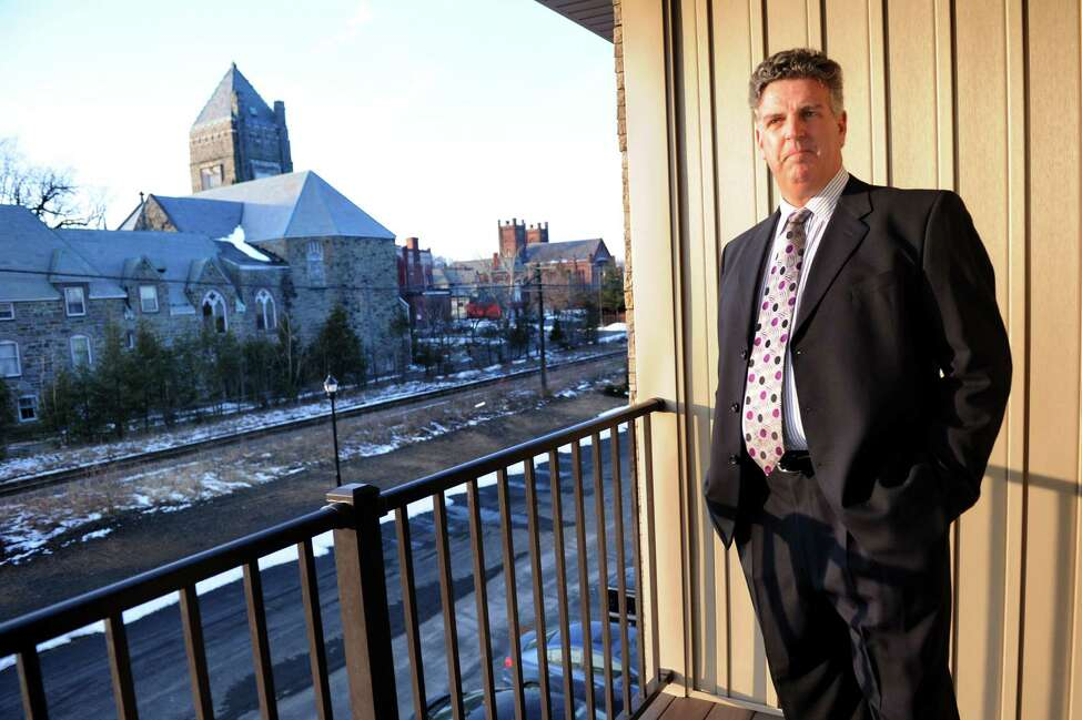 Owner Jeffory Myers stands on an apartment porch at the City Lofts of Cohoes on Thursday, Feb. 14, 2013, in Cohoes, N.Y. (Cindy Schultz / Times Union)