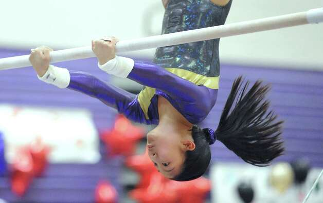 Emma Alleva of Westhill High School competes on the uneven bars during the 2013 FCIAC Girls Gymnastics Championships at Westhill High School in Stamford, Saturday, Feb. 16, 2013. Photo: Bob Luckey / Greenwich Time