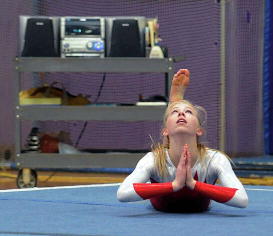 Ellen Hebrand of Greenwich High School competes in the floor exercise during the 2013 FCIAC Girls Gymnastics Championships at Westhill High School in Stamford, Saturday, Feb. 16, 2013. Photo: Bob Luckey / Greenwich Time