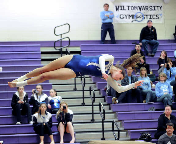 Sara Posson of Wilton High School competes in the vault during the 2013 FCIAC Girls Gymnastics Championships at Westhill High School in Stamford, Saturday, Feb. 16, 2013. Photo: Bob Luckey / Greenwich Time