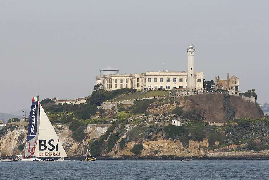 The Maserati passes Alcatraz after completing a 47-day trip from New York. Photo: James Tensuan, The Chronicle