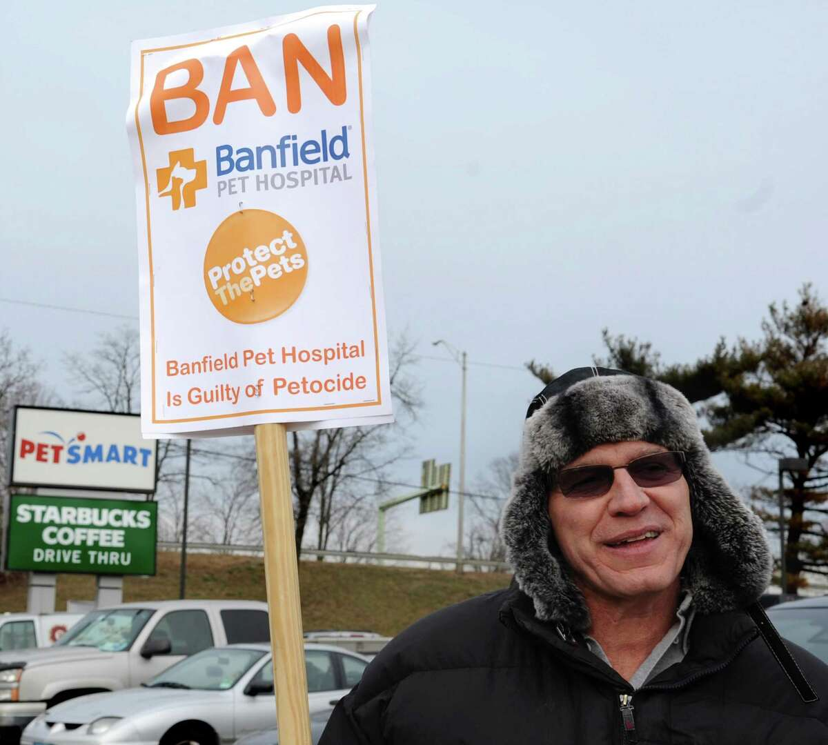 John Robb holds a picket sign outside PetSmart in Stamford on Friday, January 25, 2013. Robb was terminated from the Banfield Veterinary Clinic inside PetSmart because the company claimed he wasn't properly vaccinating pets. Robb, however, said he is protecting small pets that shouldn't receive the full doses to avoid over-vaccination.