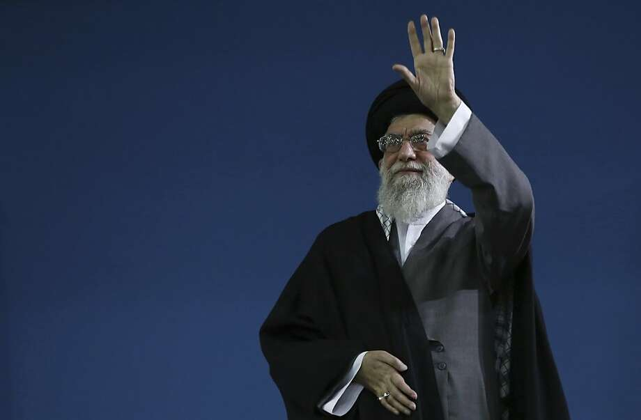 In this photo released by an official website of the Iranian supreme leader's office, Supreme Leader Ayatollah Ali Khamenei, waves to the crowd at the conclusion of his speech in Tehran, Iran, Saturday, Feb. 16, 2013. Iran's Supreme Leader said Saturday that his country is not seeking nuclear weapons, but that no world power could stop Tehran's access to an atomic bomb if it intended to build one. (AP Photo/Office of the Supreme Leader) Photo: Associated Press