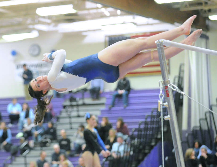 Ashley Bascom of Wilton High School competes on the uneven bars during the 2013 FCIAC Girls Gymnastics Championships at Westhill High School in Stamford, Saturday, Feb. 16, 2013. Photo: Bob Luckey / Greenwich Time