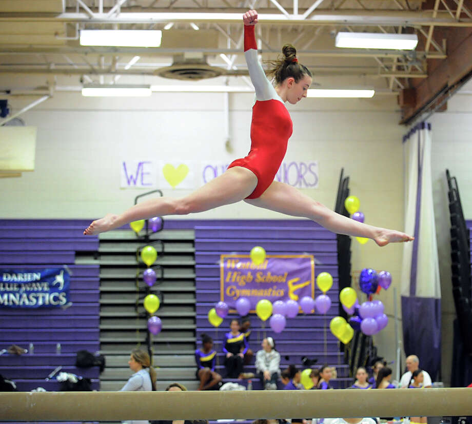 Tori Mann of Greenwich on the balance beam during the 2013 FCIAC Girls Gymnastics Championships at Westhill High School in Stamford, Saturday, Feb. 16, 2013. Photo: Bob Luckey / Greenwich Time