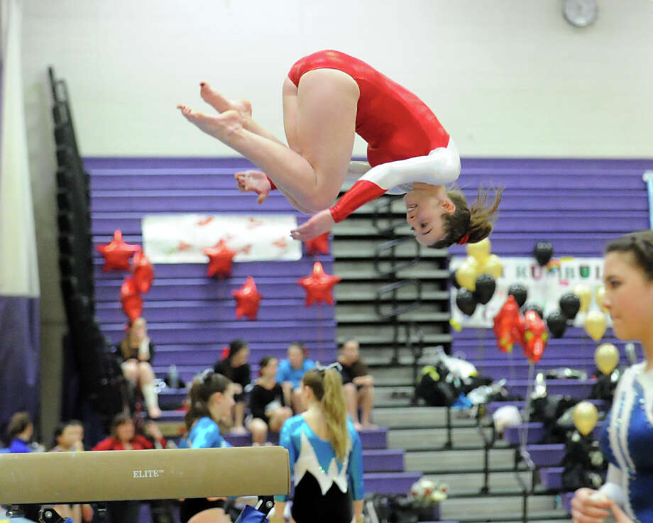 Tori Mann of Greenwich dismounts from the balance beam during the 2013 FCIAC Girls Gymnastics Championships at Westhill High School in Stamford, Saturday, Feb. 16, 2013. Photo: Bob Luckey / Greenwich Time