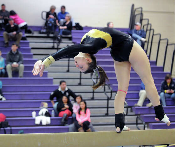Caitlyn Longwell of Trumbull High School on the balance beam during the 2013 FCIAC Girls Gymnastics Championships at Westhill High School in Stamford, Saturday, Feb. 16, 2013. Photo: Bob Luckey / Greenwich Time