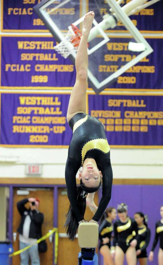 Mary DiMartino of Trumbull High School on the balance beam during the 2013 FCIAC Girls Gymnastics Championships at Westhill High School in Stamford, Saturday, Feb. 16, 2013. Photo: Bob Luckey / Greenwich Time