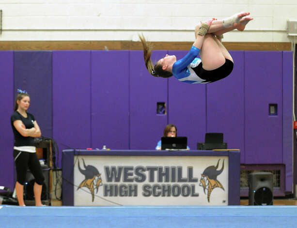 Sophia Stanley of Staples competes in the floor exercise during the 2013 FCIAC Girls Gymnastics Championships at Westhill High School in Stamford, Saturday, Feb. 16, 2013. Photo: Bob Luckey / Greenwich Time
