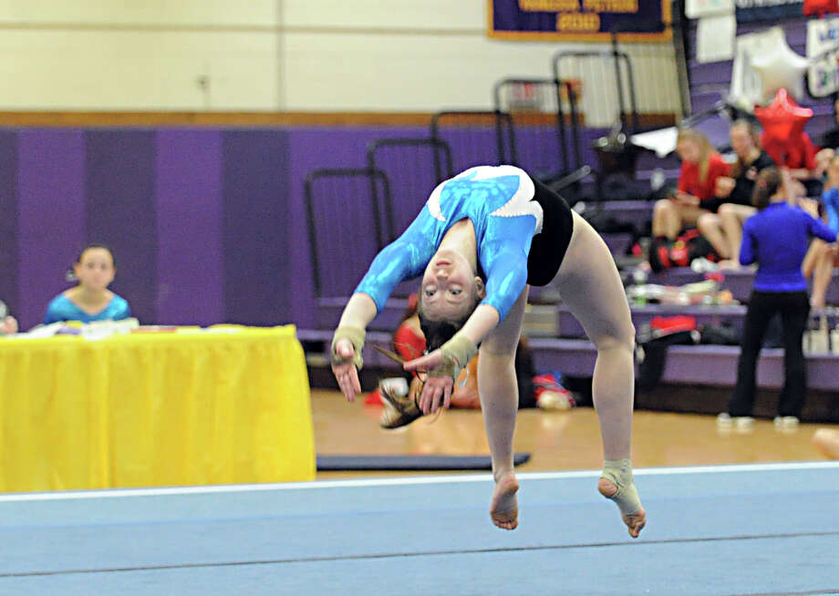Andrea Mahieu of Staples competes in the floor exercise during the 2013 FCIAC Girls Gymnastics Championships at Westhill High School in Stamford, Saturday, Feb. 16, 2013. Photo: Bob Luckey / Greenwich Time