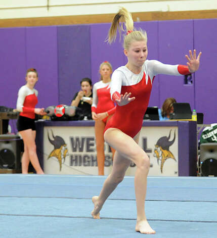 Ellen Hebrand of Greenwich High School competes in the floor exercise during the 2013 FCIAC Girls Gymnastics Championships at Westhill High School in Stamford, Saturday, Feb. 16, 2013. . Photo: Bob Luckey / Greenwich Time