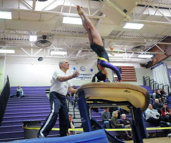 Emma Alleva of Westhill High School competes in the vault during the 2013 FCIAC Girls Gymnastics Championships at Westhill High School in Stamford, Saturday, Feb. 16, 2013. Photo: Bob Luckey / Greenwich Time