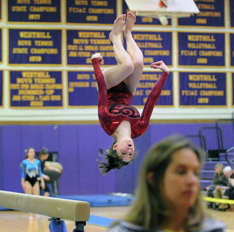 Nicole Kirven of St. Joe's competes on the balance beam during the 2013 FCIAC Girls Gymnastics Championships at Westhill High School in Stamford, Saturday, Feb. 16, 2013. Photo: Bob Luckey / Greenwich Time