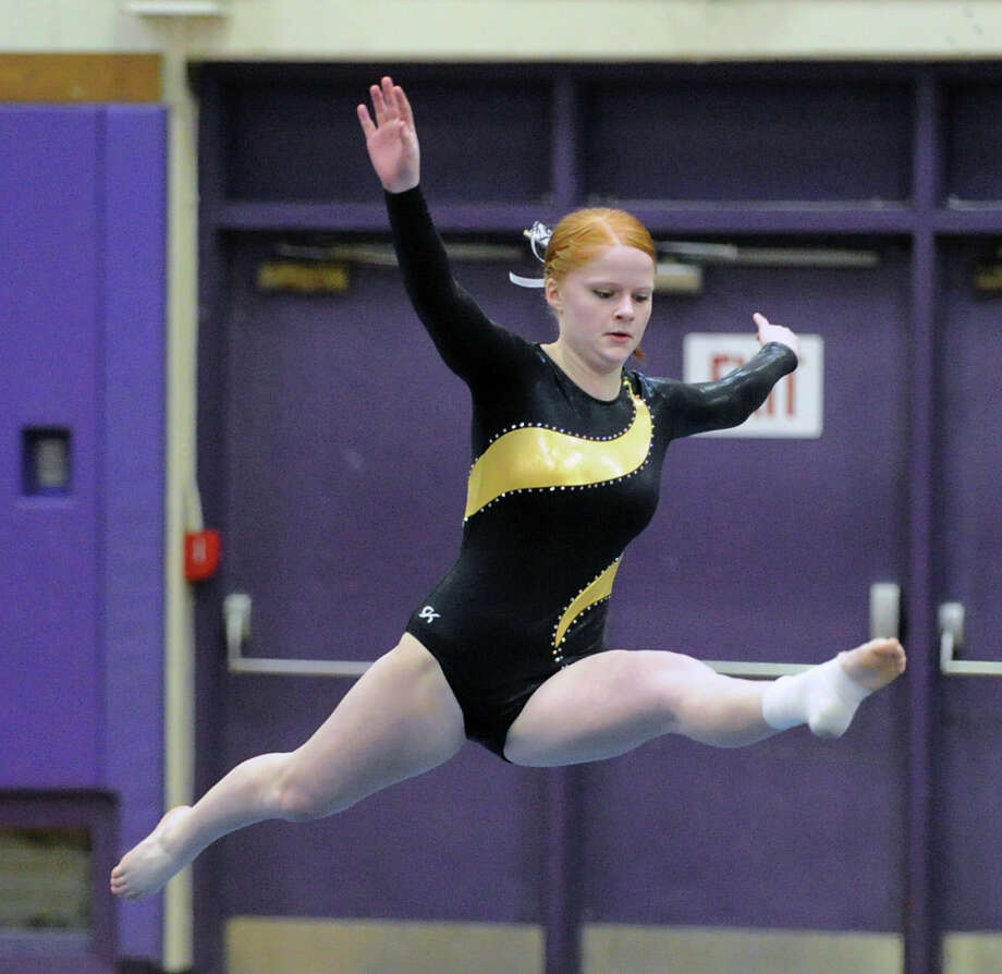 Tara Oliver of Trumbull competes in the floor exercise during the 2013 FCIAC Girls Gymnastics Championships at Westhill High School in Stamford, Saturday, Feb. 16, 2013. Photo: Bob Luckey / Greenwich Time