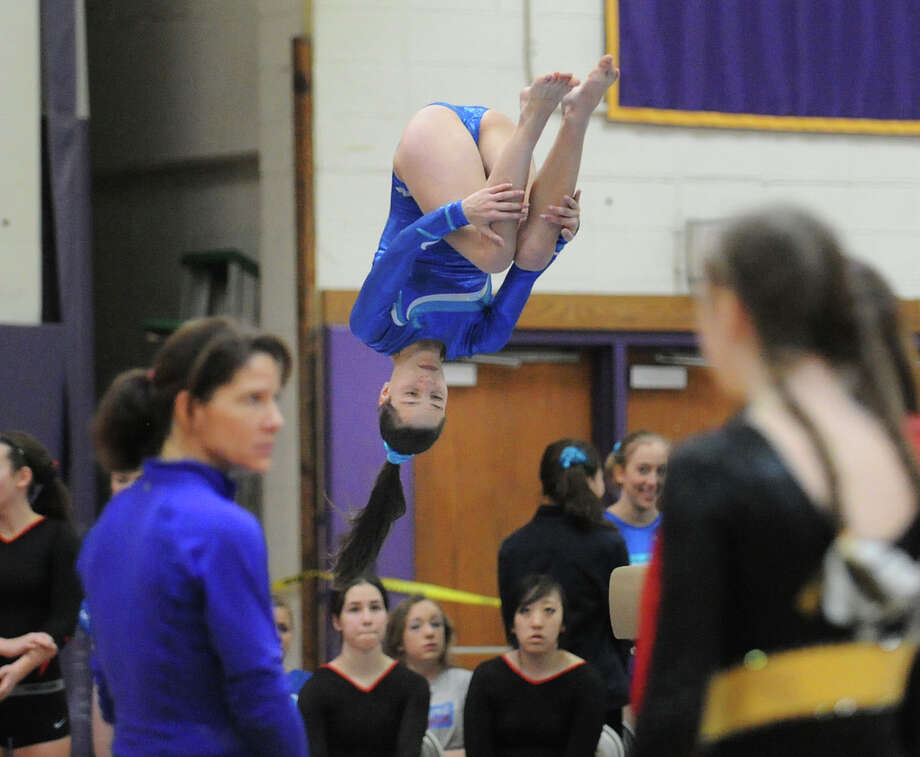 Marya von Schmidt of Darien High School dismounts from the balance beamduring the 2013 FCIAC Girls Gymnastics Championships at Westhill High School in Stamford, Saturday, Feb. 16, 2013. Photo: Bob Luckey / Greenwich Time
