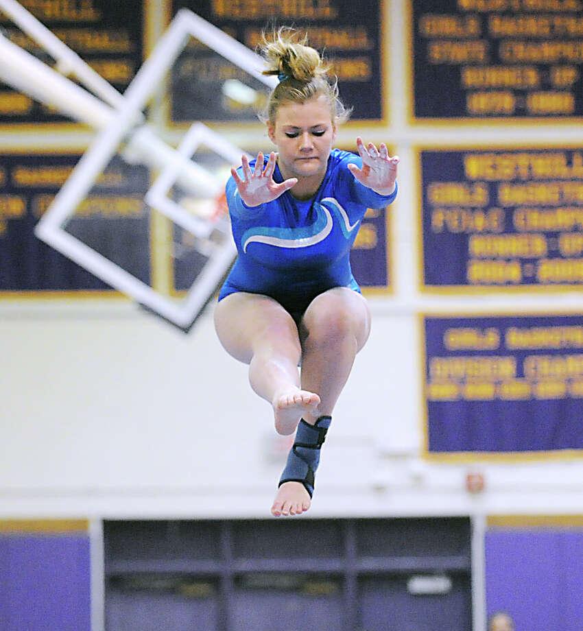 Sarah Petti of Darien High School on the balance beam during the 2013 FCIAC Girls Gymnastics Championships at Westhill High School in Stamford, Saturday, Feb. 16, 2013. Photo: Bob Luckey / Greenwich Time
