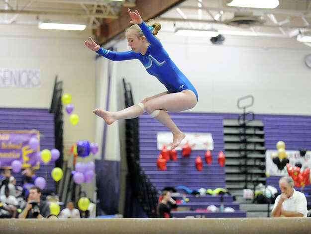 Caroline Congdon of Darien High School on the balance beam during the 2013 FCIAC Girls Gymnastics Championships at Westhill High School in Stamford, Saturday, Feb. 16, 2013. Photo: Bob Luckey / Greenwich Time
